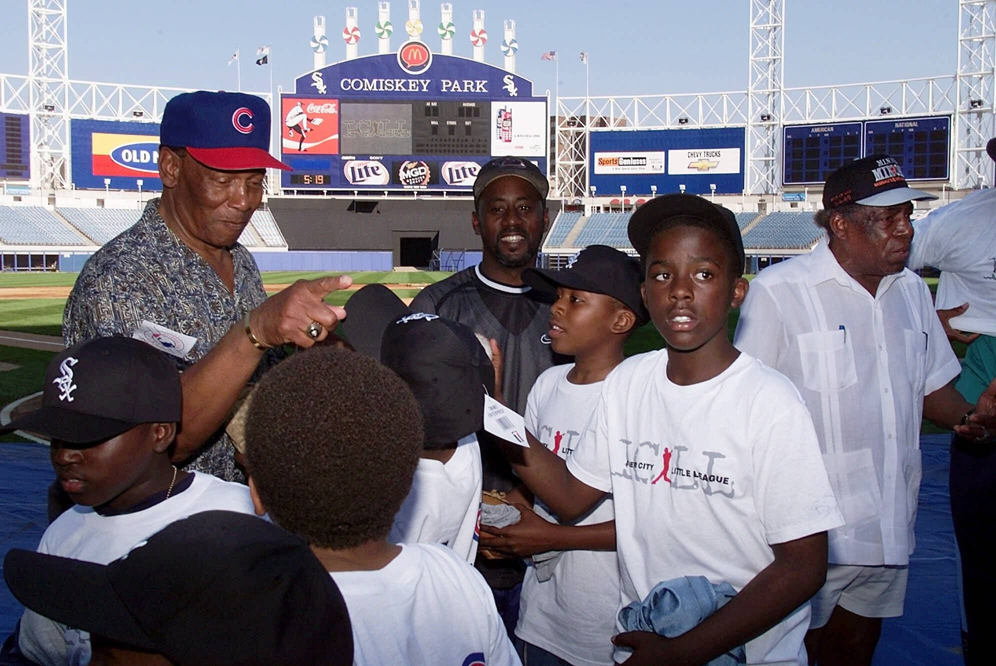 Chicago has lost baseball legends Ernie Banks, left, and Minnie Minoso, far right. Both men spent a lifetime in the city promoting the game and their favorite teams.