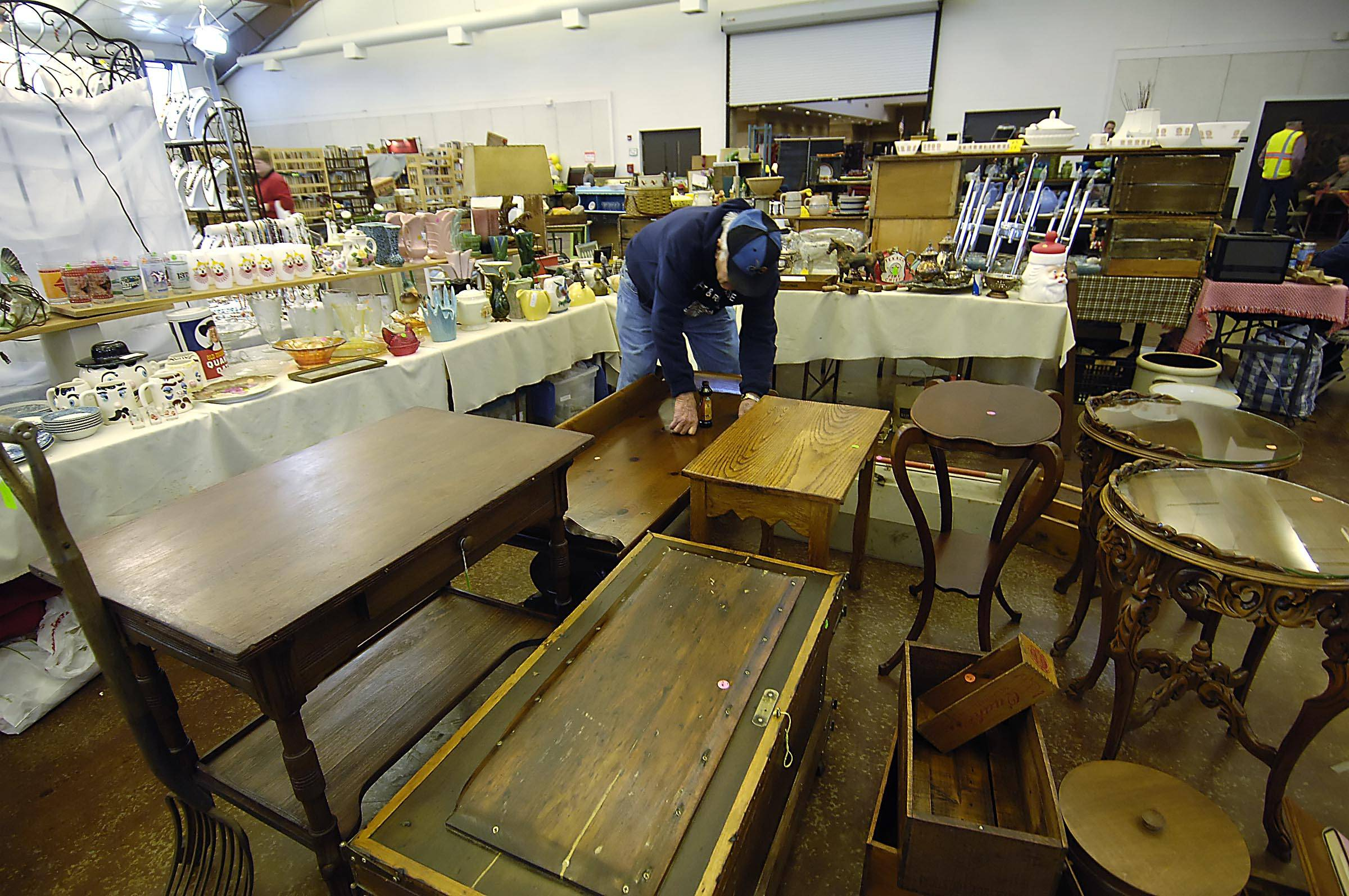 Superior Harold Jacobsgaard Of Shorewood Polishes His Wooden Tables That Were For  Sale Sunday At The First