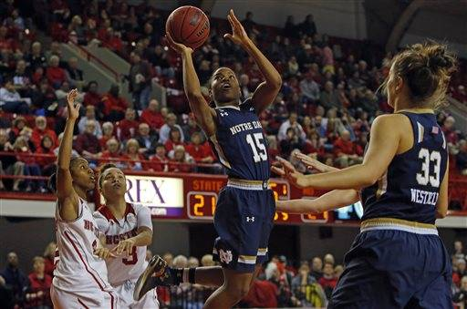 Notre Dame 's Lindsay Allen (15) drives to the basket between North Carolina State's Len'Nique Brown-Hoskin (2) and Miah Spencer (3) and teammate Kathryn Westbeld (33) during the first half of an NCAA college basketball game, Sunday, March 1, 2015, in Raleigh, N.C. (AP Photo/Karl B DeBlaker)