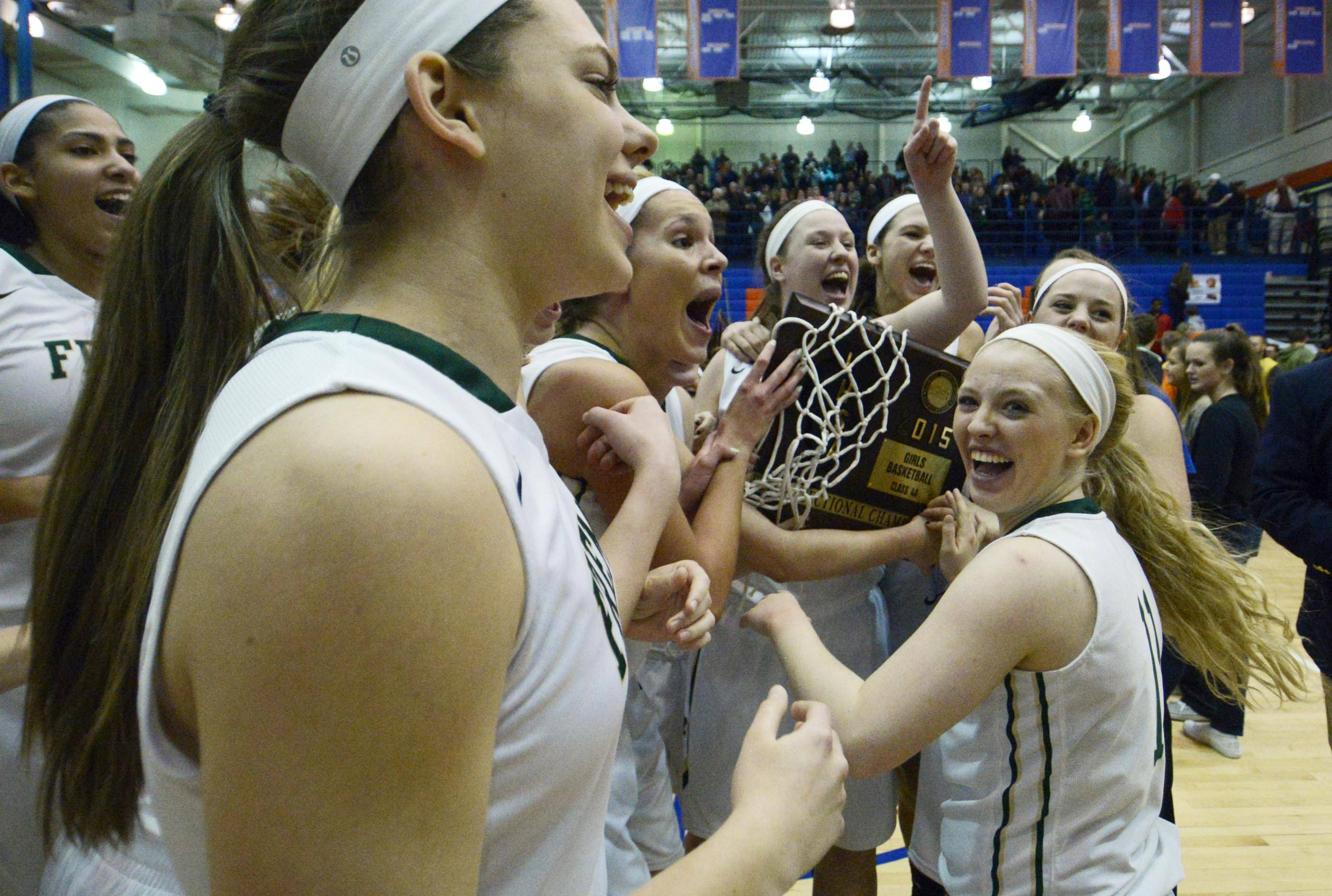 Fremd players celebrate a win over Huntley Monday in the Class 4A Hoffman Estates supersectional.