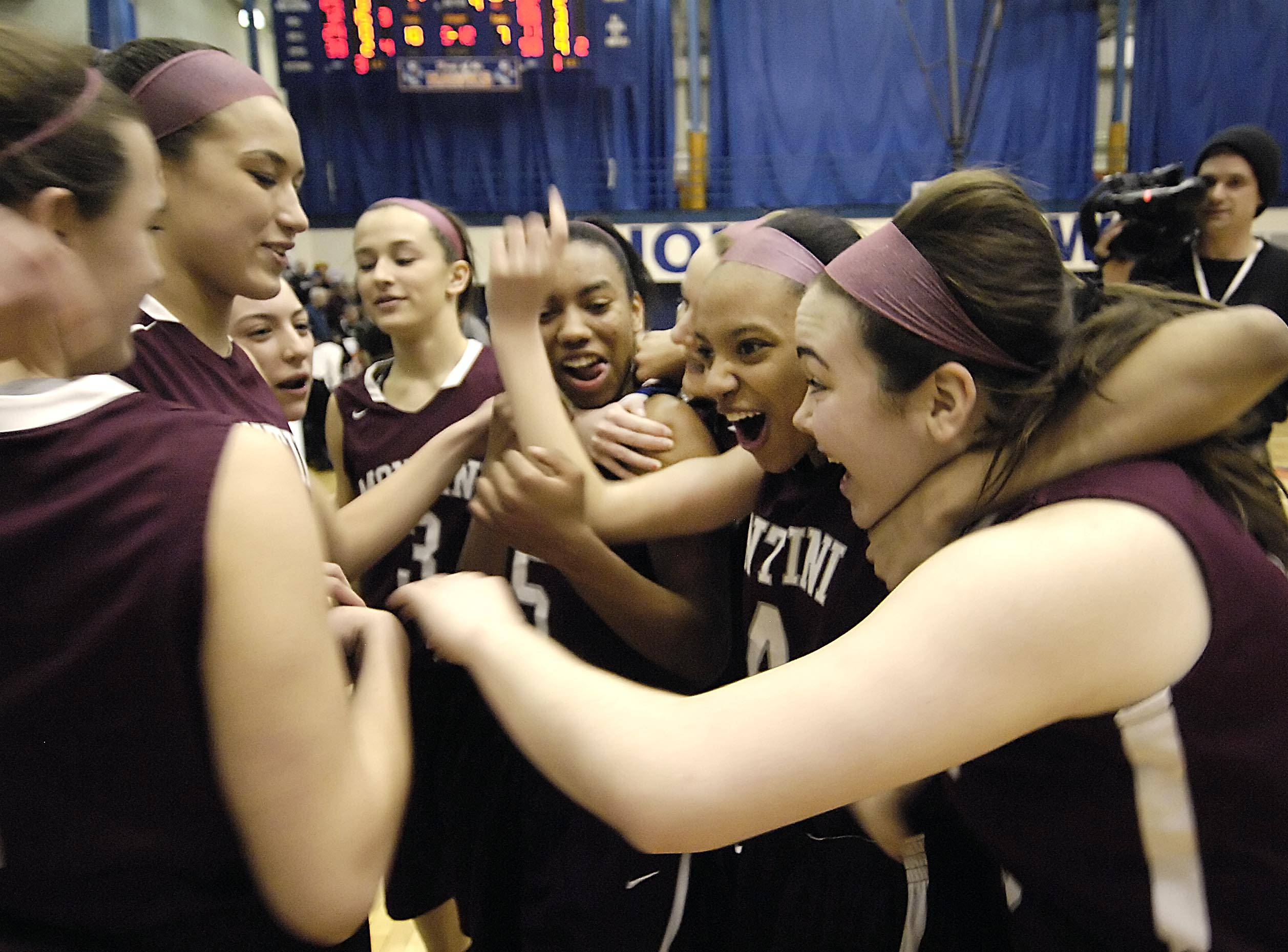 Montini players celebrate victory over Antioch on Monday in the Class 3A Hoffman Estates supersectional.