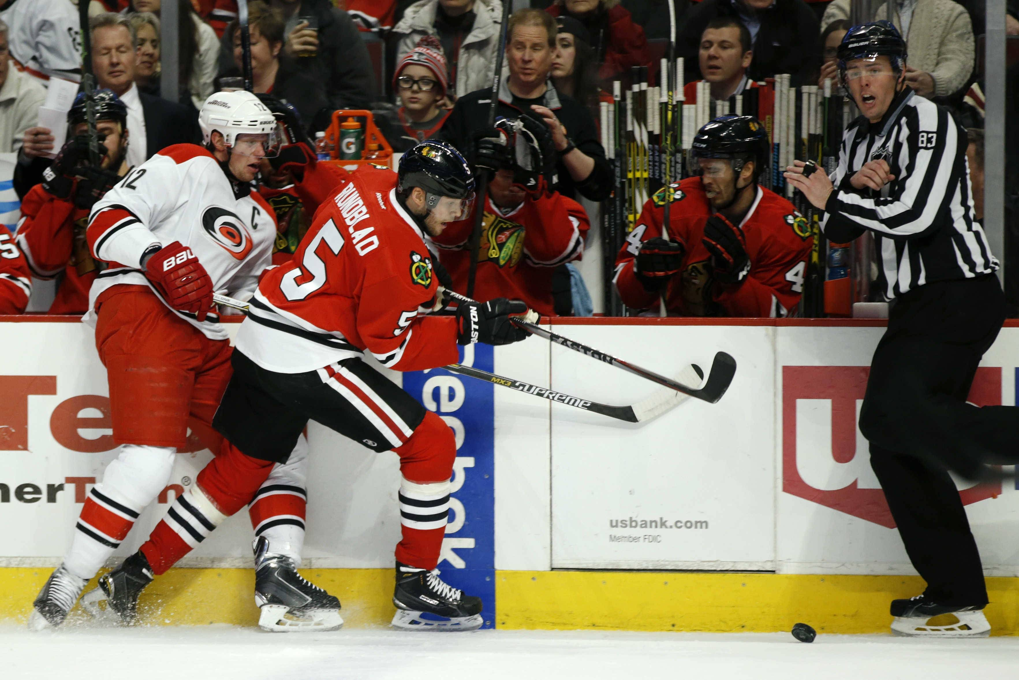 Chicago Blackhawks defenseman David Rundblad (5) and Carolina Hurricanes center Eric Staal, left, collide during the first period of an NHL hockey game Monday, March 2, 2015, in Chicago.