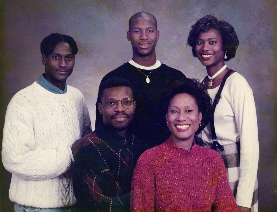 "At home in Hoffman Estates in the 1990s with his wife, Ona, and children, from left, Conrad ""Atiba,"" Christopher and Candace ""Candy,"" Conrad Taylor is winning acclaim for his book, ""Path to Freedom."" Taylor tells his story of being the first resident of Guyana to graduate from West Point."