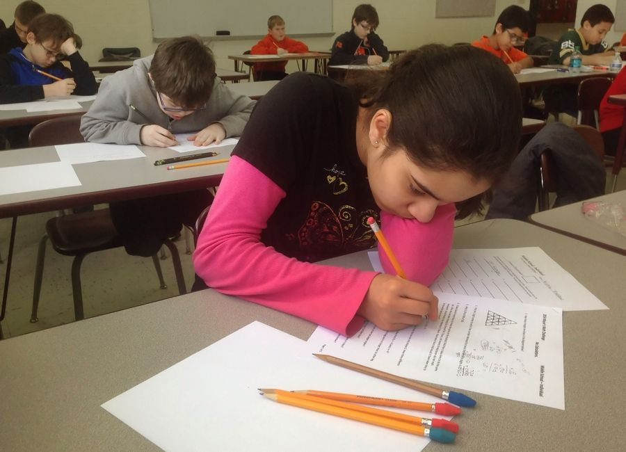 Students work a problem at the inaugural Mayor's Cup Math Challenge last year in Mundelein.