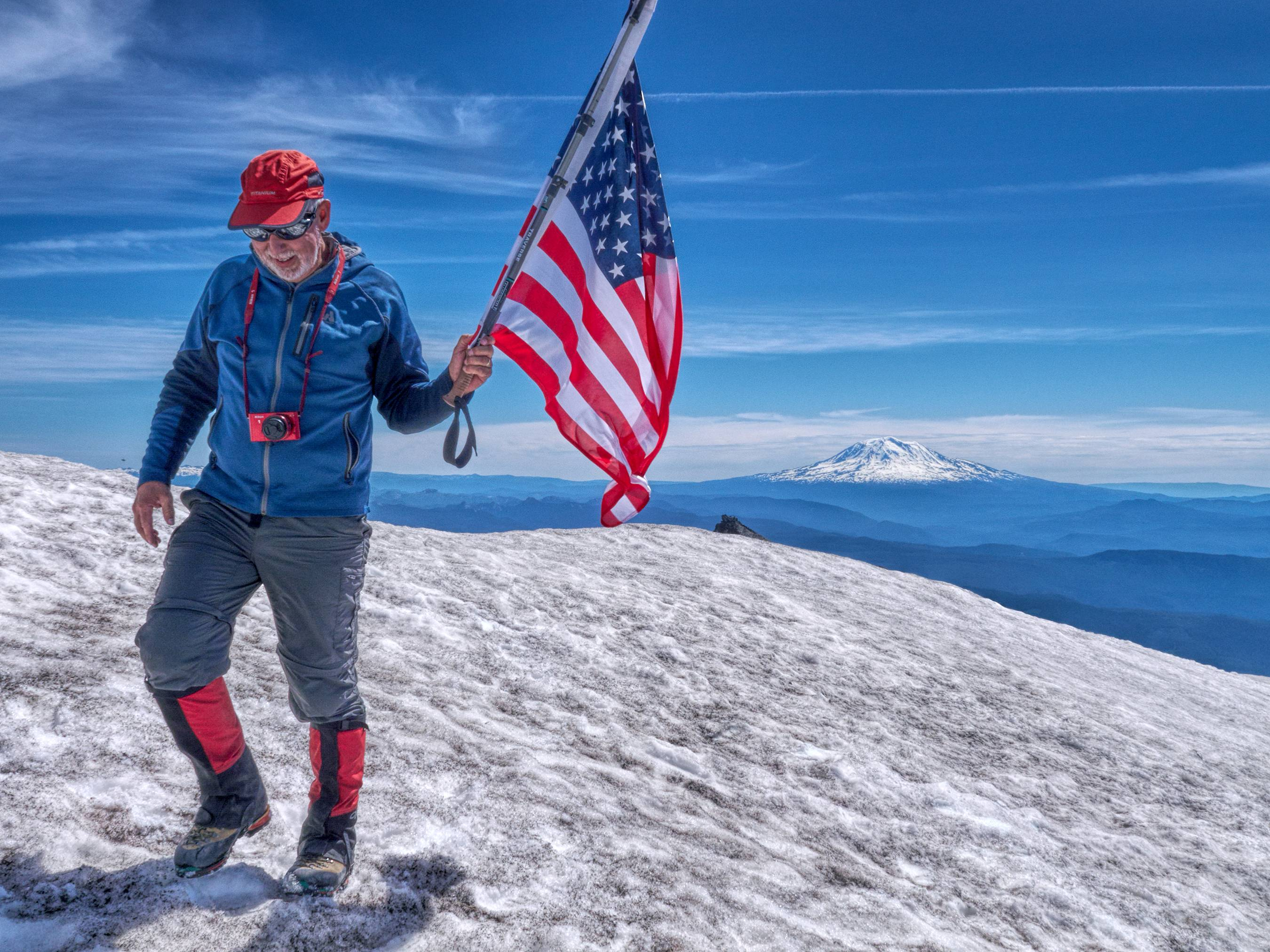 Bruce Alber of Vancouver, Washington, celebrates the Fourth of July and reaching summit of Mount St. Helens. He has climbed it six times since 2011.