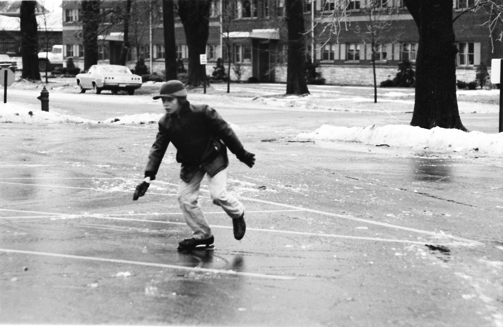 A boy skates on a frozen parking lot after a 1965 winter ice storm that hit the northwest suburbs.