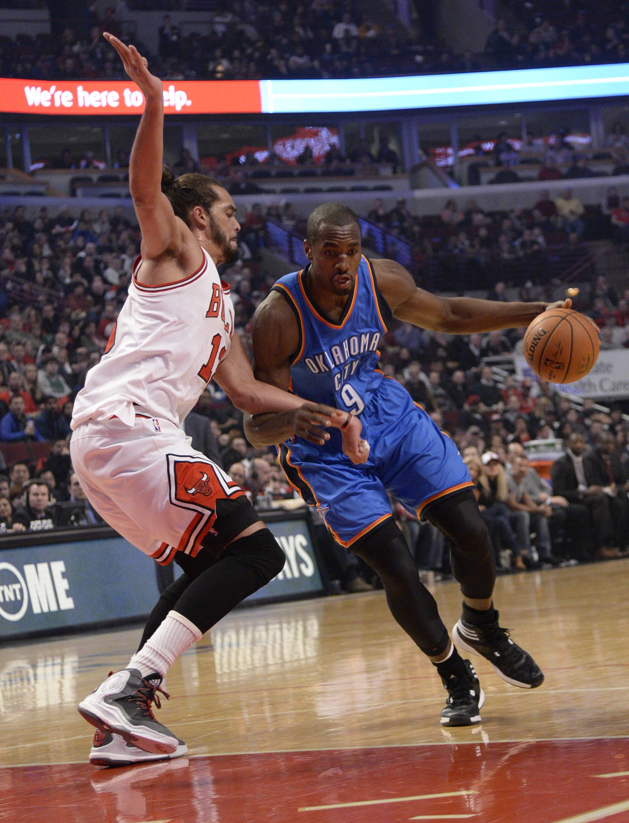 Oklahoma City Thunder forward Serge Ibaka (9) is defended by Chicago Bulls center Joakim Noah (13) during the first half of an NBA basketball game, Thursday, March 5, 2015 in Chicago.