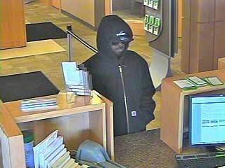 Aurora police and the FBI are searching for this man in connection with a robbery at the Associated Bank at 301 W, Galena Blvd.