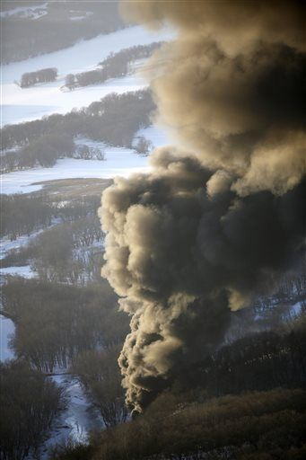 Smoke rises from the scene of a train derailment Thursday, March 5, 2015, near Galena, Ill. A BNSF Railway freight train loaded with crude oil derailed around 1:20 p.m. in a rural area where the Galena River meets the Mississippi, said Jo Daviess County Sheriff's Sgt. Mike Moser.