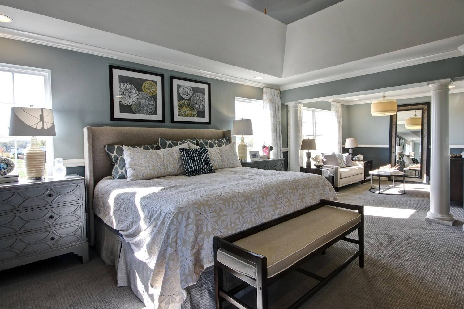 In the Harvard model at Bowes Creek, the master suite features architectural columns that separate the sleeping and sitting areas.