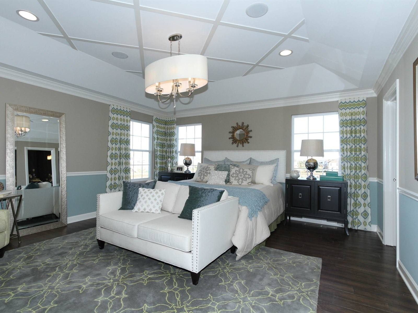 The tray ceiling in the Columbus model at Mayfair features a diamond pattern and chandelier, which is a popular decorative item in master suites now.