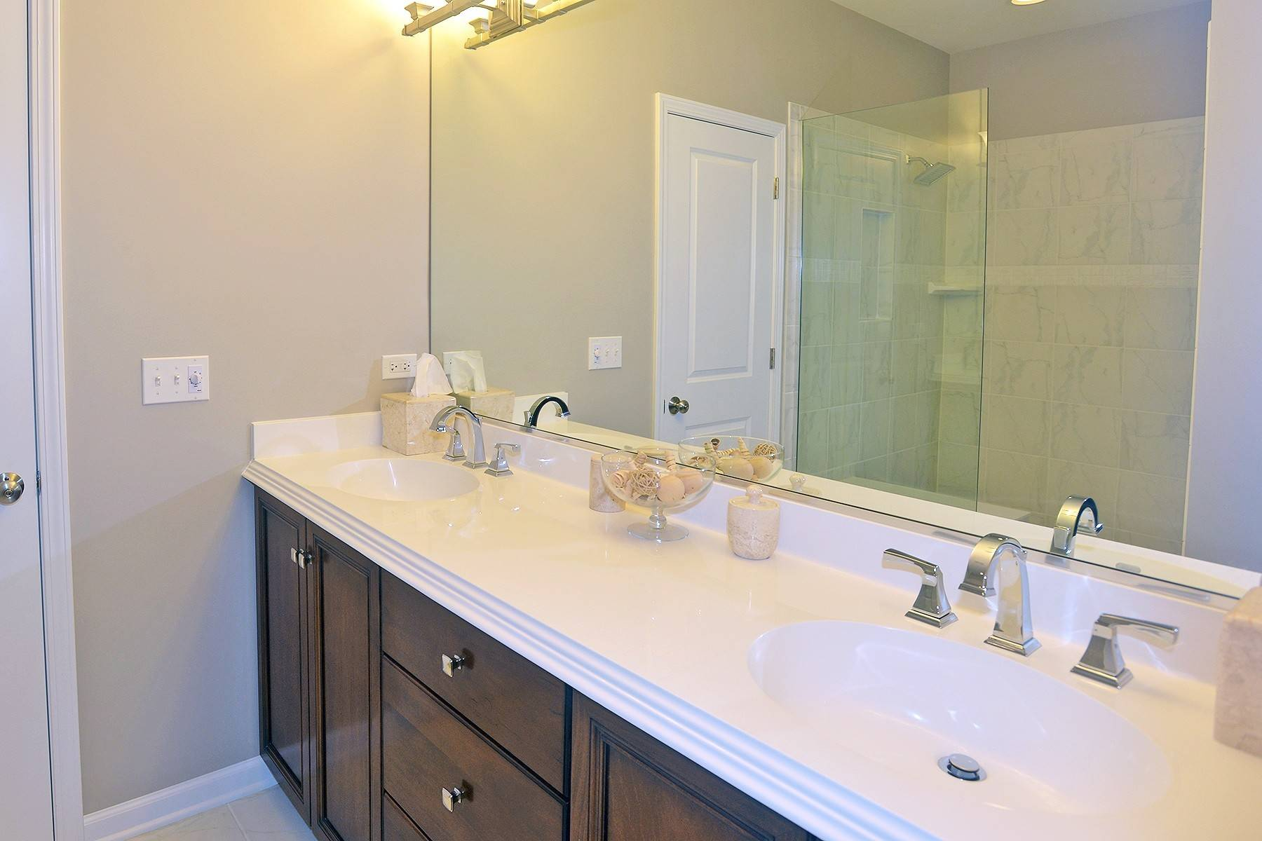 The master bath at Courthouse Square in Wheaton features an oversized walk-in shower because many buyers today prefer a large shower over a soaking tub.