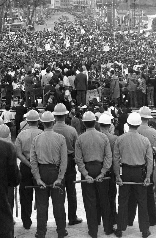 In this March 25, 1965 file photo, state troopers block the steps of the Alabama state capitol at Montgomery, Ala. from civil rights marchers at the end of their five-day march from Selma, Ala.