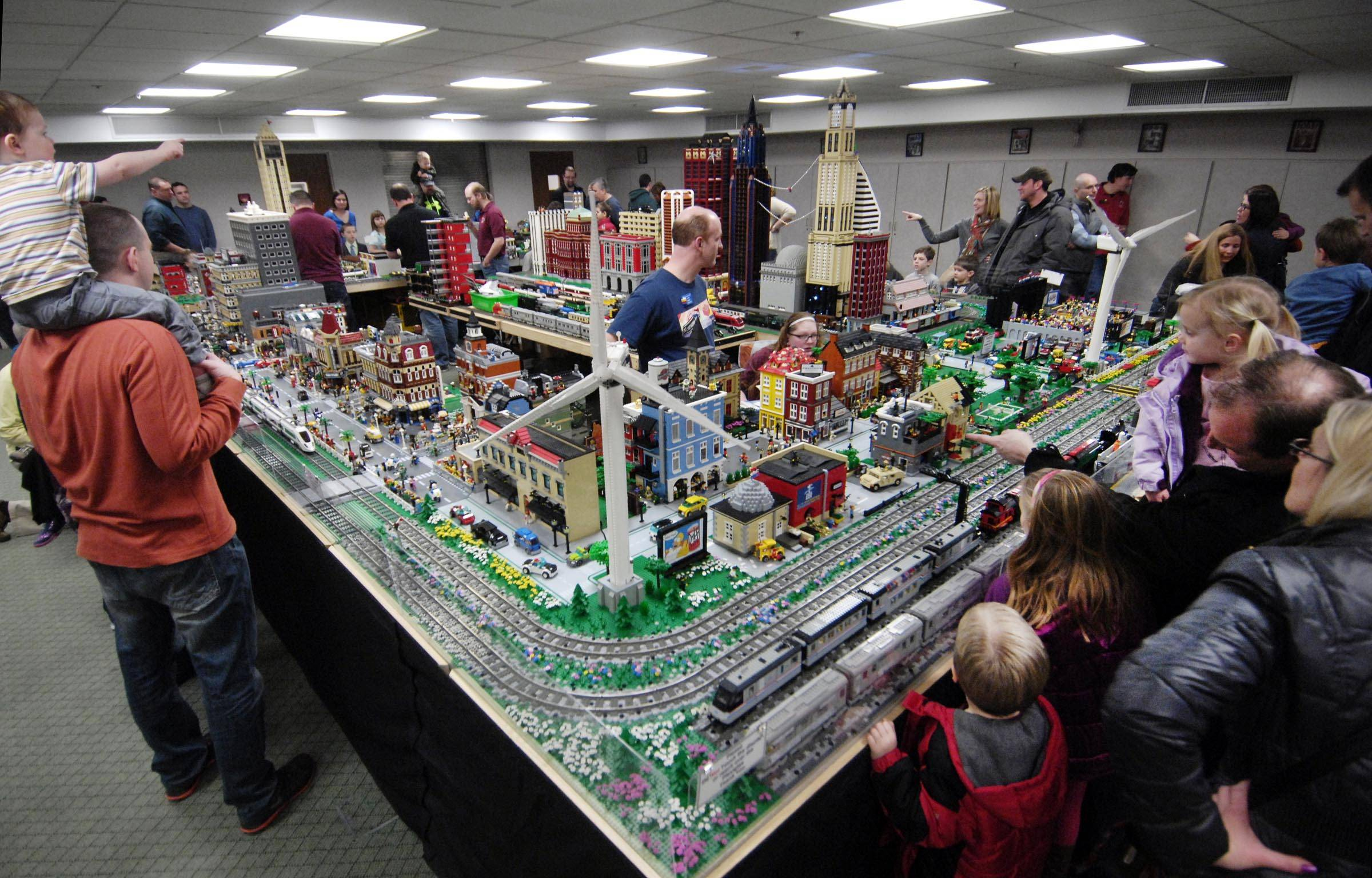 A steady stream of visitors filled a lower-level meeting room Sunday at an exhibit by the Northern Illinois LEGO Train Club at the Geneva Public Library.