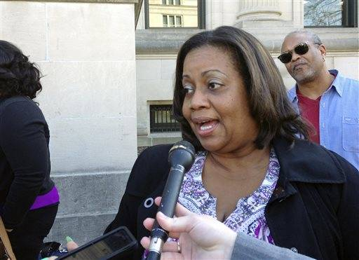 Gwen Harrison, 53, a state librarian from Springfield, Ill., speaks to reporters outside the Illinois Supreme Court in Springfield, Wednesday, March 11, 2015, saying her life savings is at stake as the high court considers whether to throw out the state's pension overhaul. Harrison is a lead plaintiff in the case heard Wednesday before the court.
