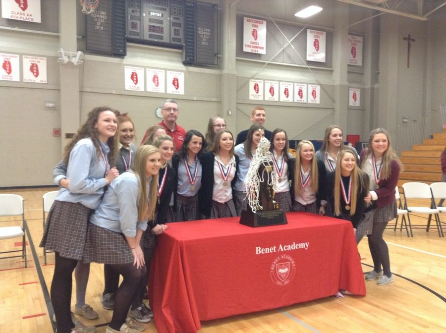 The Benet Academy Lady Redwings celebrate their first Illinois High School Association girls basketball championship during a Wednesday pep rally in Lisle.