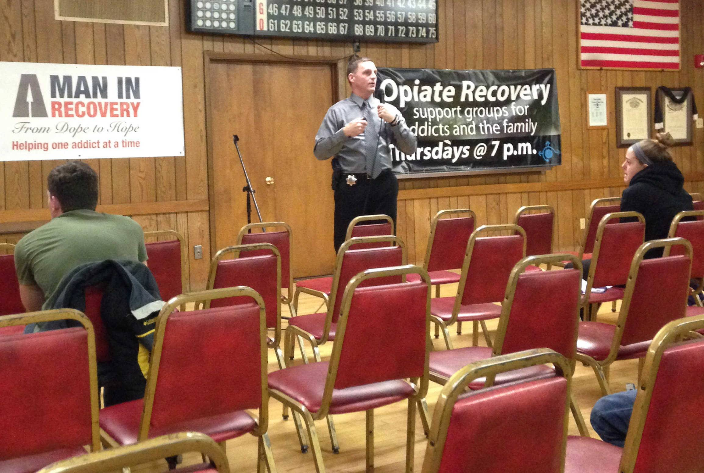 Naperville police officer Shaun Ferguson describes telltale signs of drug use at an anti-heroin forum Tuesday in Batavia.