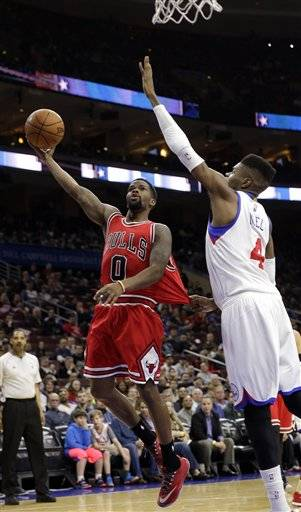 Chicago Bulls Aaron Brooks 0 Goes Up For A Shot As Philadelphia 76ers