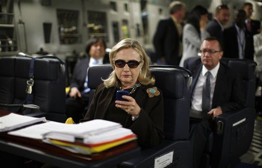 FILE - In this Oct. 18, 2011, file photo, then-Secretary of State Hillary Rodham Clinton checks her Blackberry from a desk inside a C-17 military plane upon her departure from Malta, in the Mediterranean Sea, bound for Tripoli, Libya. It's a photo that became an Internet meme: Hillary Rodham Clinton, wearing sunglasses, staring at her BlackBerry. Now it's becoming a focal point for Republicans on the House committee that's investigating the deadly attacks in Benghazi, Libya. The chairman, South Carolina Republican Trey Gowdy, wants to know why the panel has no emails from the day the photo was taken as Clinton, then the secretary of state, was en route to Tripoli.