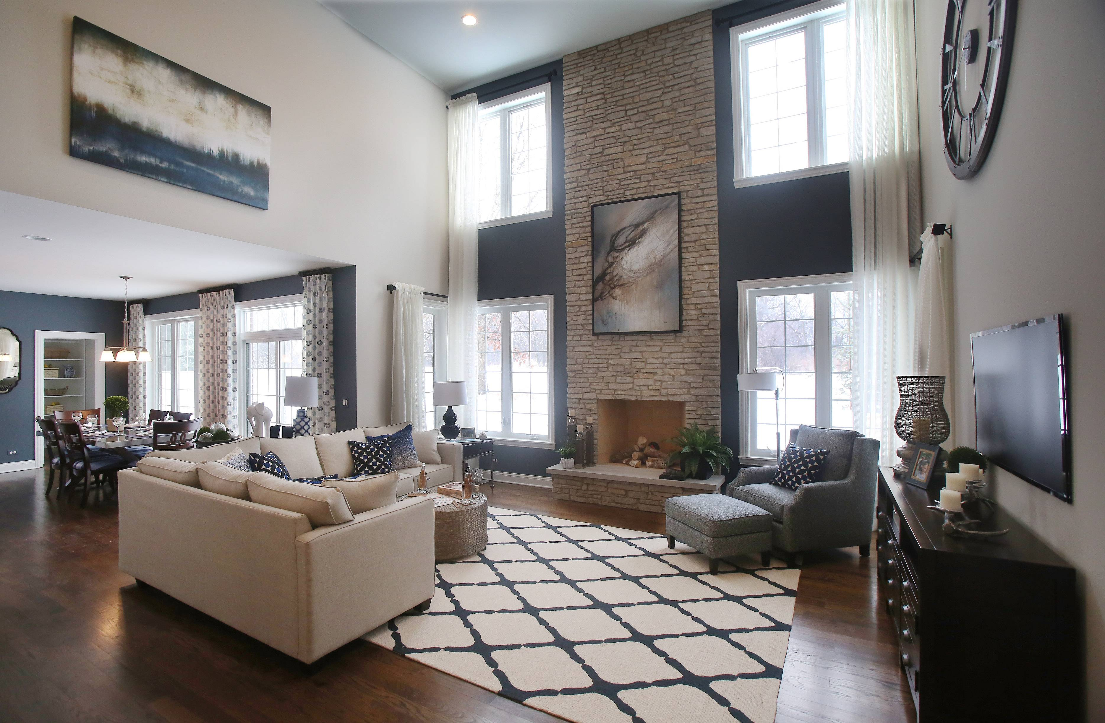 Decor Was Selected To Complement The Two Story Fieldstone Fireplace In The  Linden Model At
