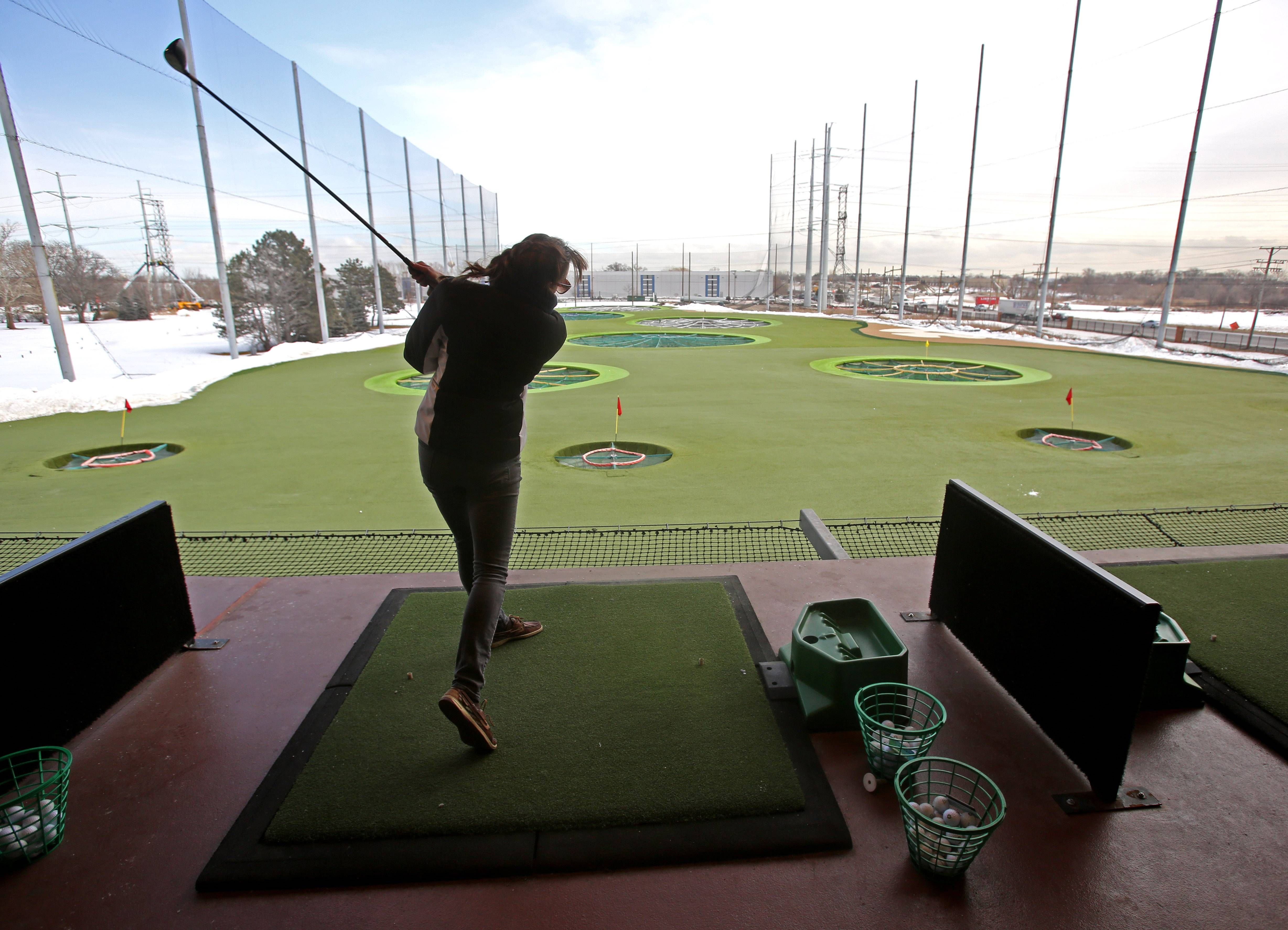 Claire Mulcrone, of Elk Grove Village, prepares for the golf season at Topgolf in Wood Dale.