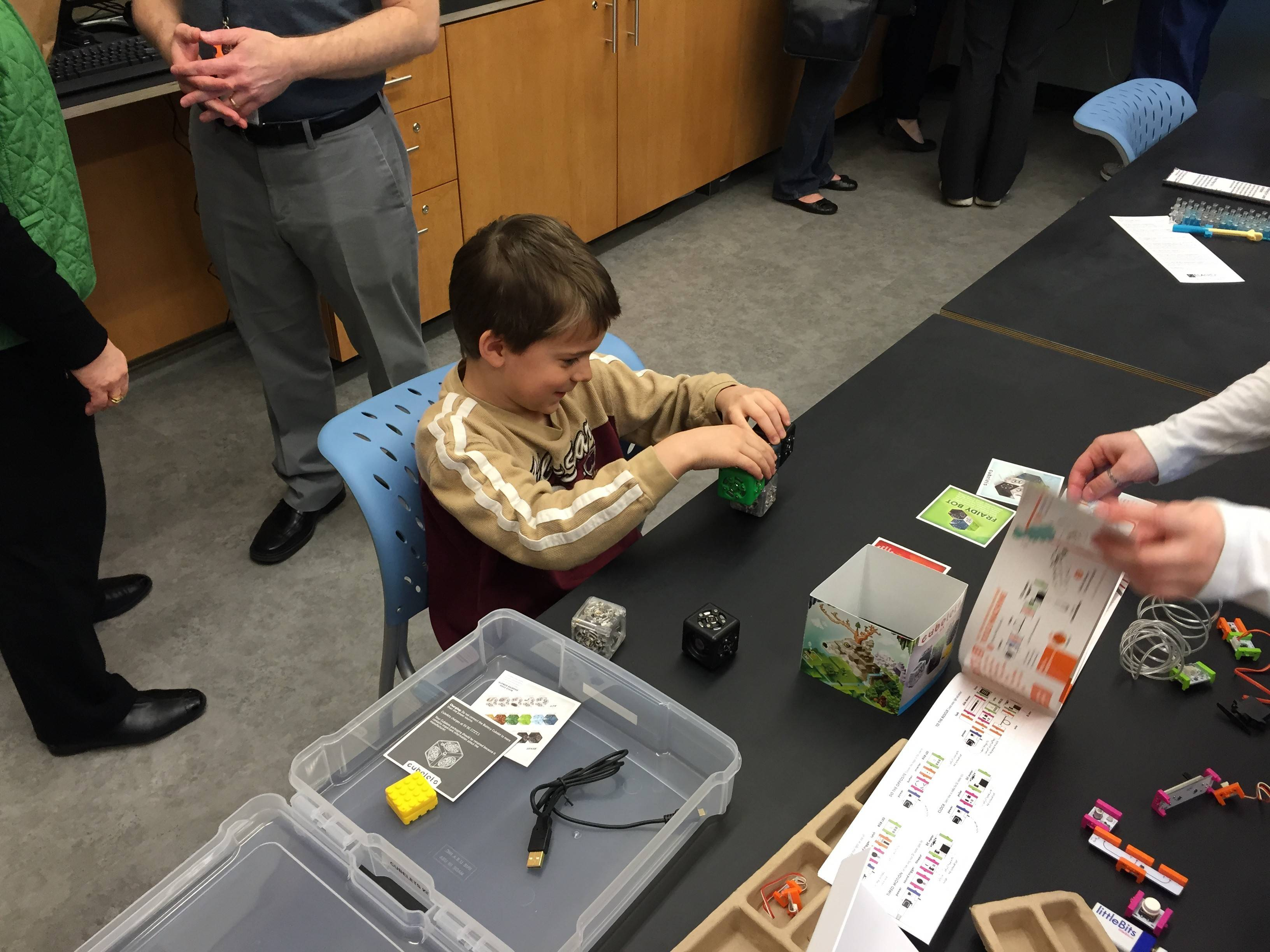 Eight-year-old Joey Polites works with Cubelets while visiting the Ela Area Public Library's new Forge makerspace.