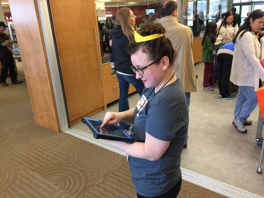 Leah White, head of popular materials at the Ela Area Public Library, wears a 3-D printed tiara at the grand opening for the library's new Forge makerspace.