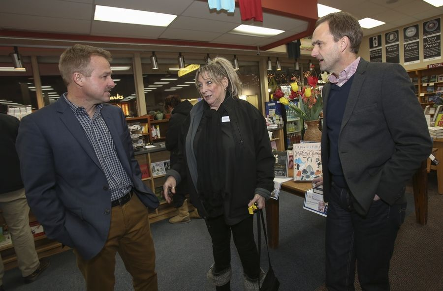 "Dave Ferguson, left, and his brother Jon Ferguson, right, chat with Pam Christensen of Plainfield, who came out to Anderson's Bookshop in Naperville for the signing of their new book ""Finding Your Way Back to God; 5 Awakenings to Your New Life."""