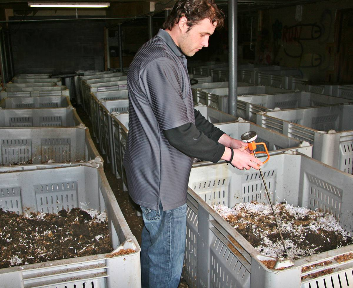 Michael Flood tests the temperature of one of the BioBins in the laboratory at Flood Brothers Disposal/Recycling plant.