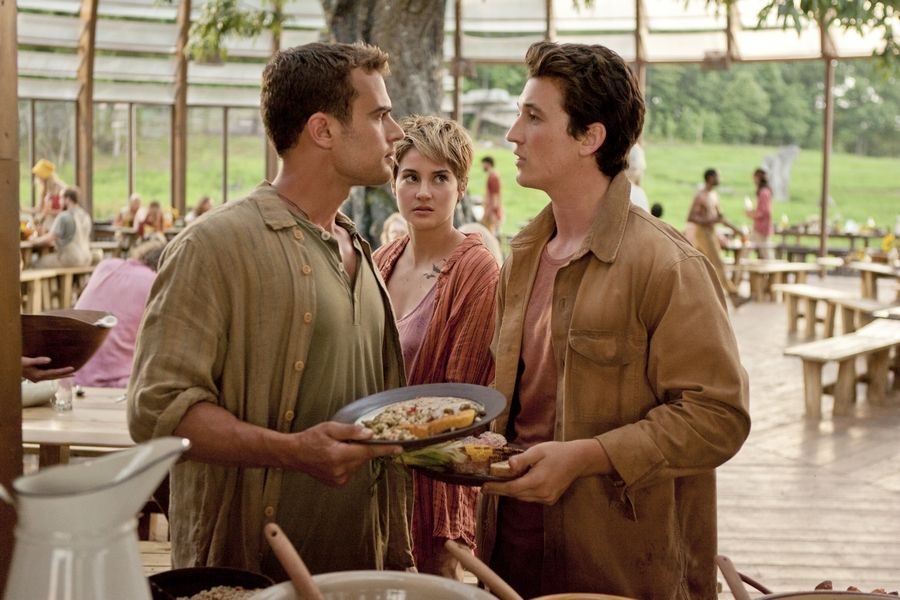 "Theo James, left, Shailene Woodley and Miles Teller star in ""The Divergent Series: Insurgent,"" which opens in theaters Friday."