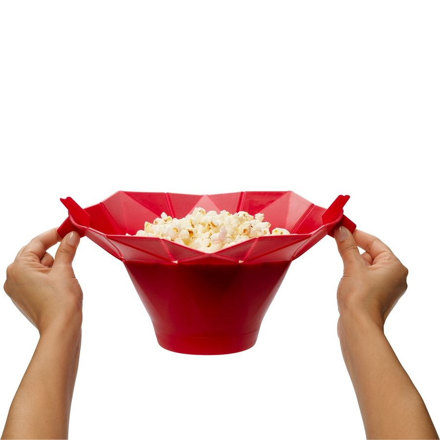 Pop it: Microwave popcorn with minimal unpopped kernels is the promise chef'n stands by for its flexible, silicone Pop Top corn popper. Fill the inner divot with about 5 tablespoons of your favorite kernels, fold the flaps over and put it in your microwave. As the kernels heat, they pop and the container expands, allowing the early popping kernels to get out of the way of the late-popping kernels. The tabs stay cool for easy opening. $19.99. Available at national retailers.