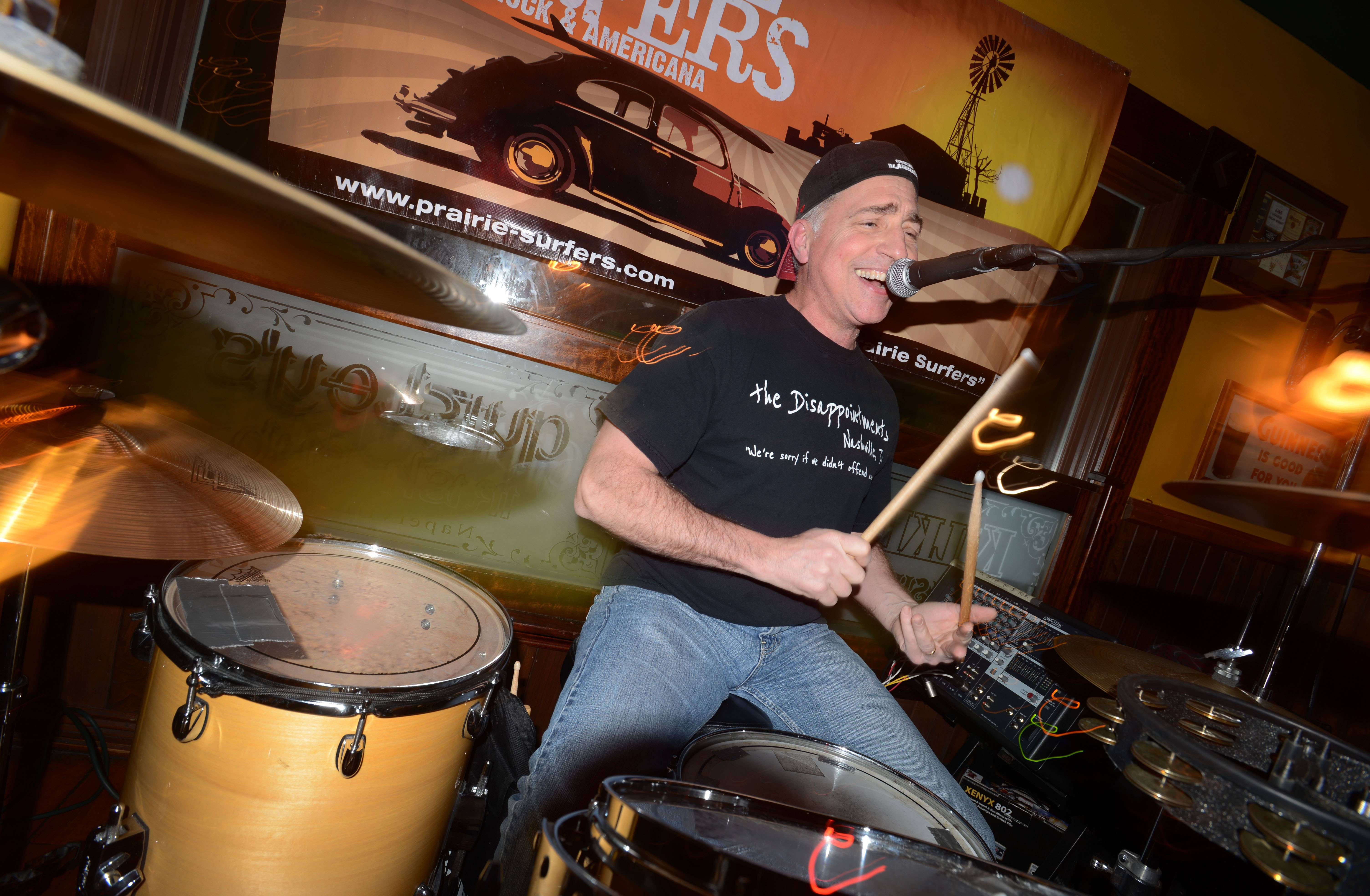 Steve Mores, 57, of Aurora is back to playing drums in his popular cover band, Prairie Surfers, at Quigley's Irish Pub in Naperville.