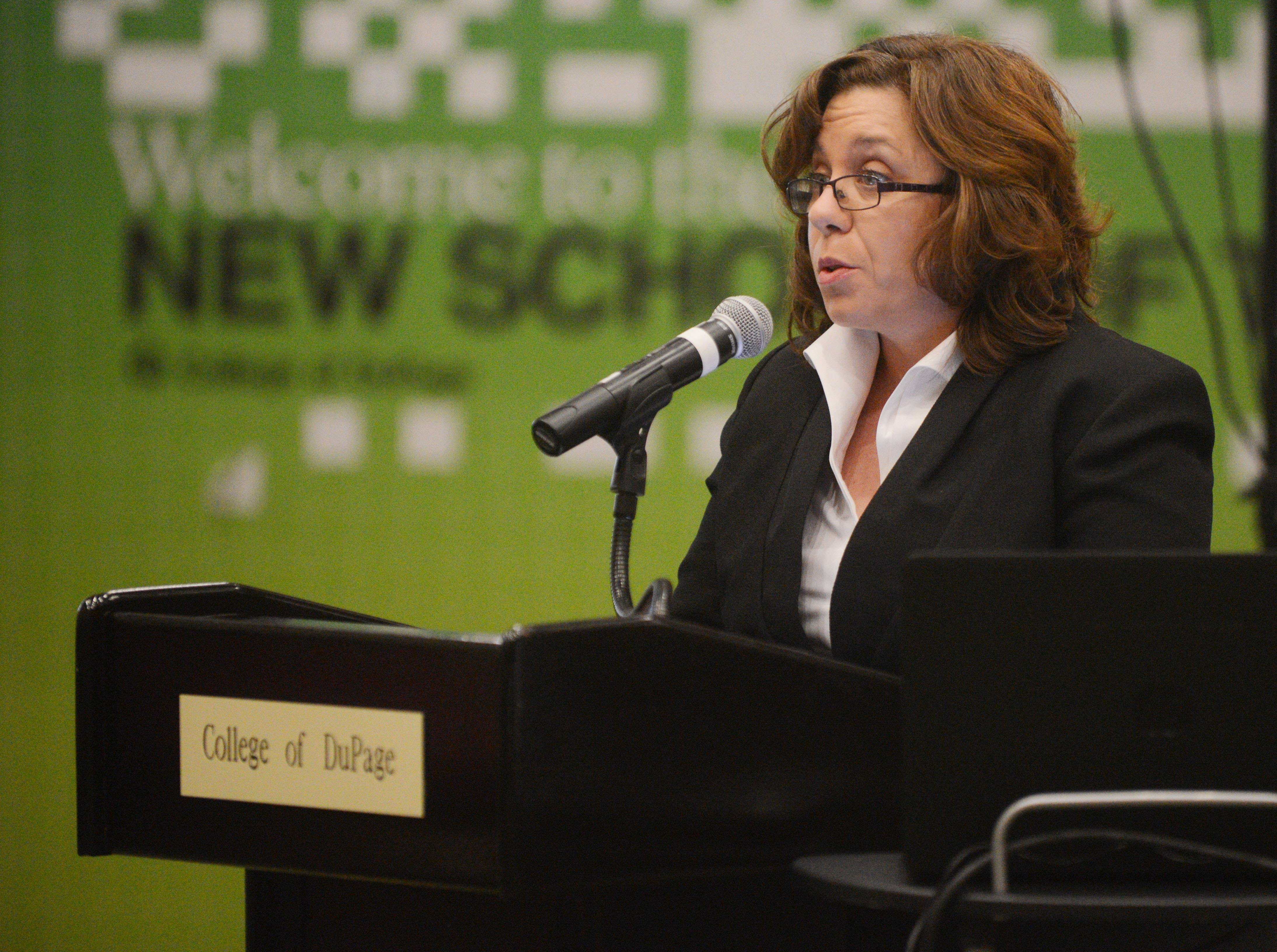 Laura Reigle voices her opinion about College of DuPage hiring a public relations firm at Thursday night's board meeting, saying the college already has a full-time spokesman.