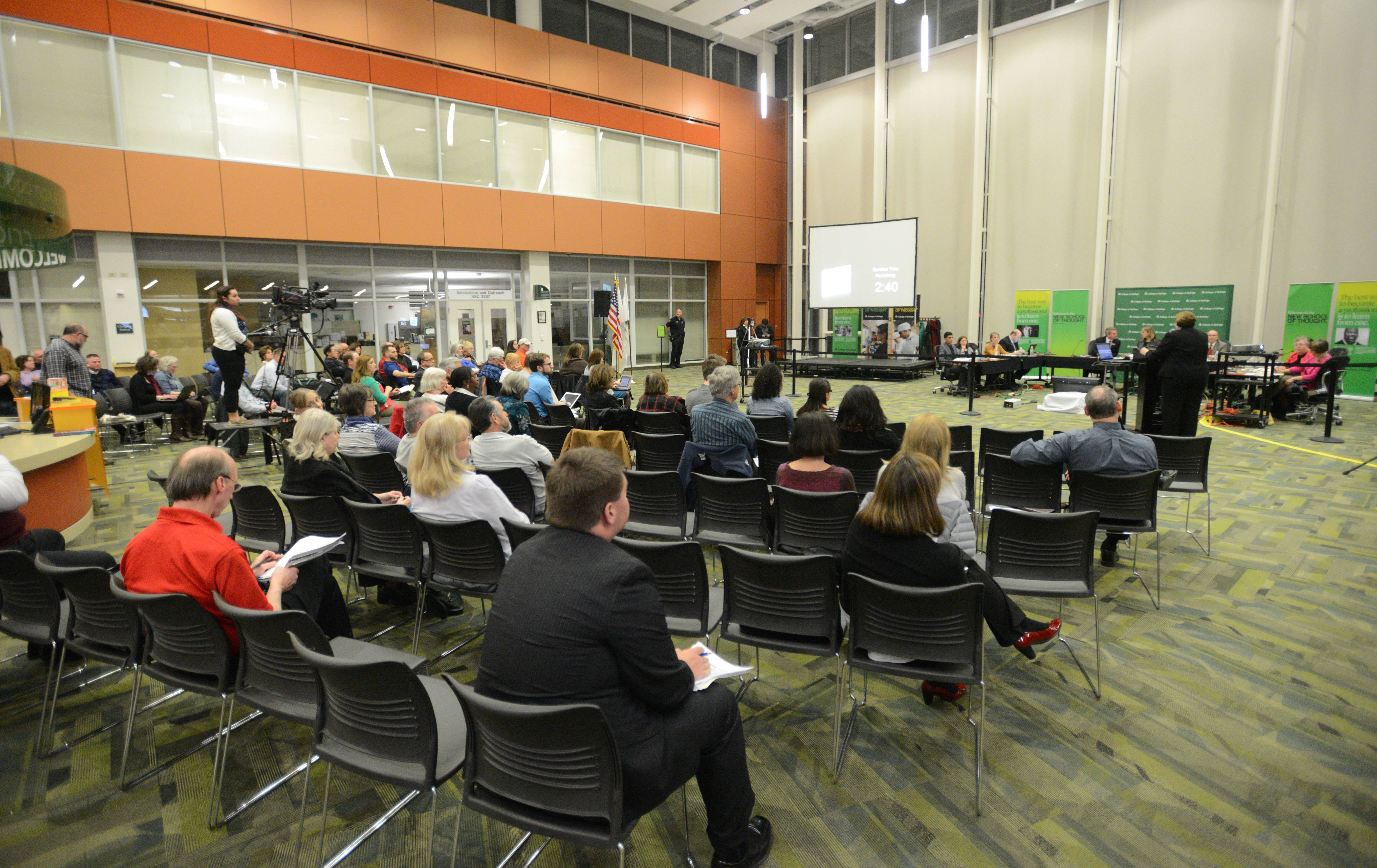 Paul Michna/pmichna@dailyherald.comWell over 100 people attended the College of DuPage Board meeting Thursday night. The board voted to hire a public relations firm despite the public opinion.