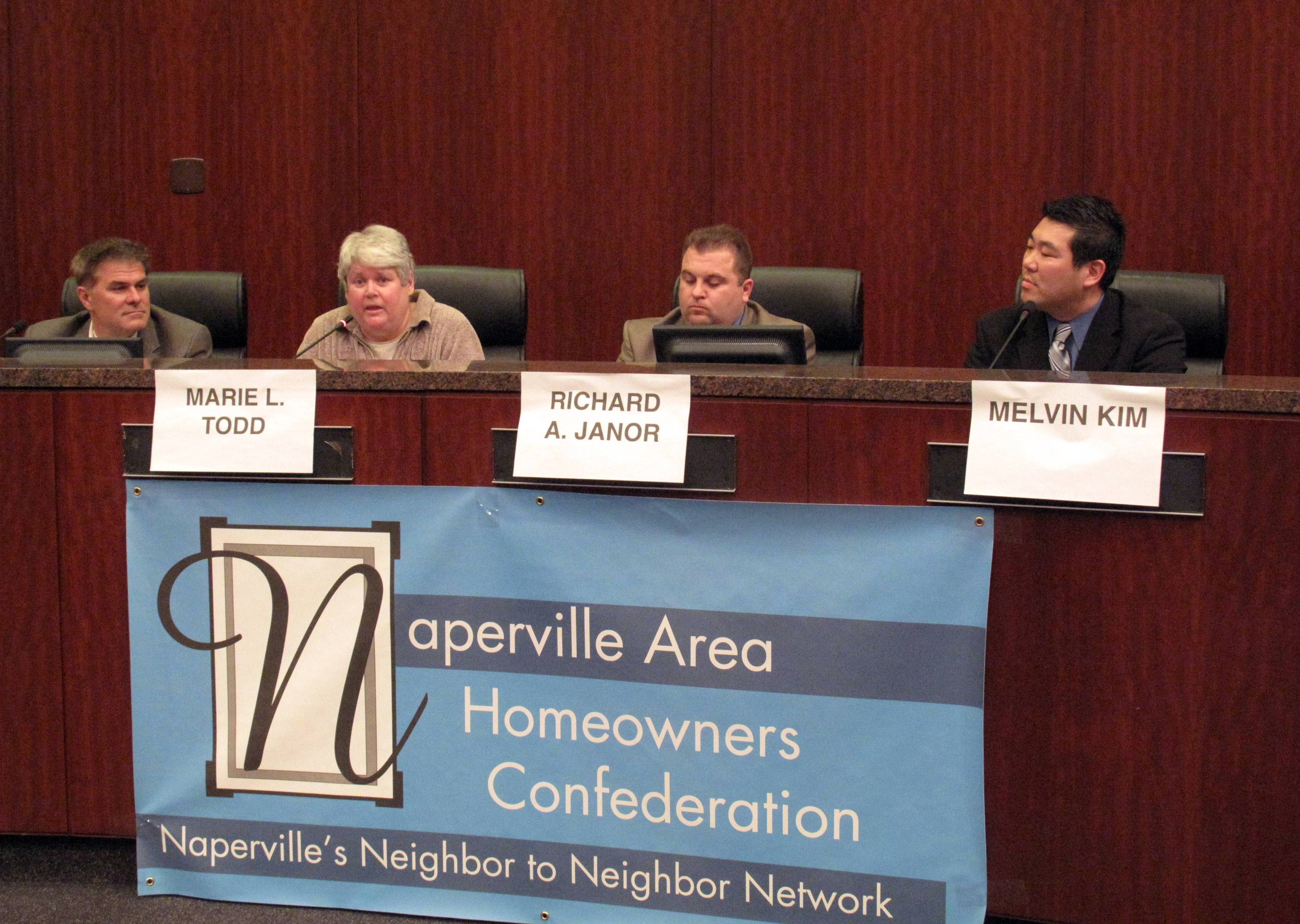 Naperville park board candidate Marie Todd, second from left, says the district should continue increasing property taxes by the maximum amount allowed to afford new construction. Candidates Jim Ensign, Rich Janor and Melvin Kim, all of whom are seeking three seats on the board, disagreed with Todd during a forum sponsored by the Naperville Area Homeowners Confederation.