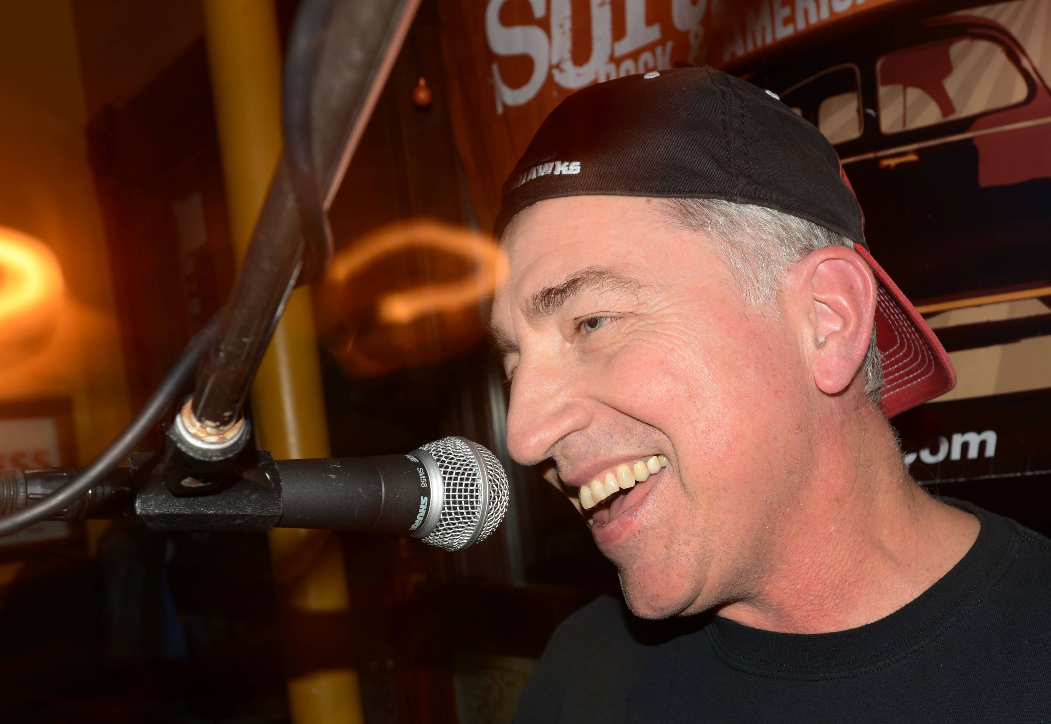 Drummer Steve Mores performs at Quigley's Irish Pub in Naperville with his band, the Prairie Surfers, a few months after having a new type of surgery to remove a tumor at his brain stem that was causing facial numbness, nausea and balance problems.