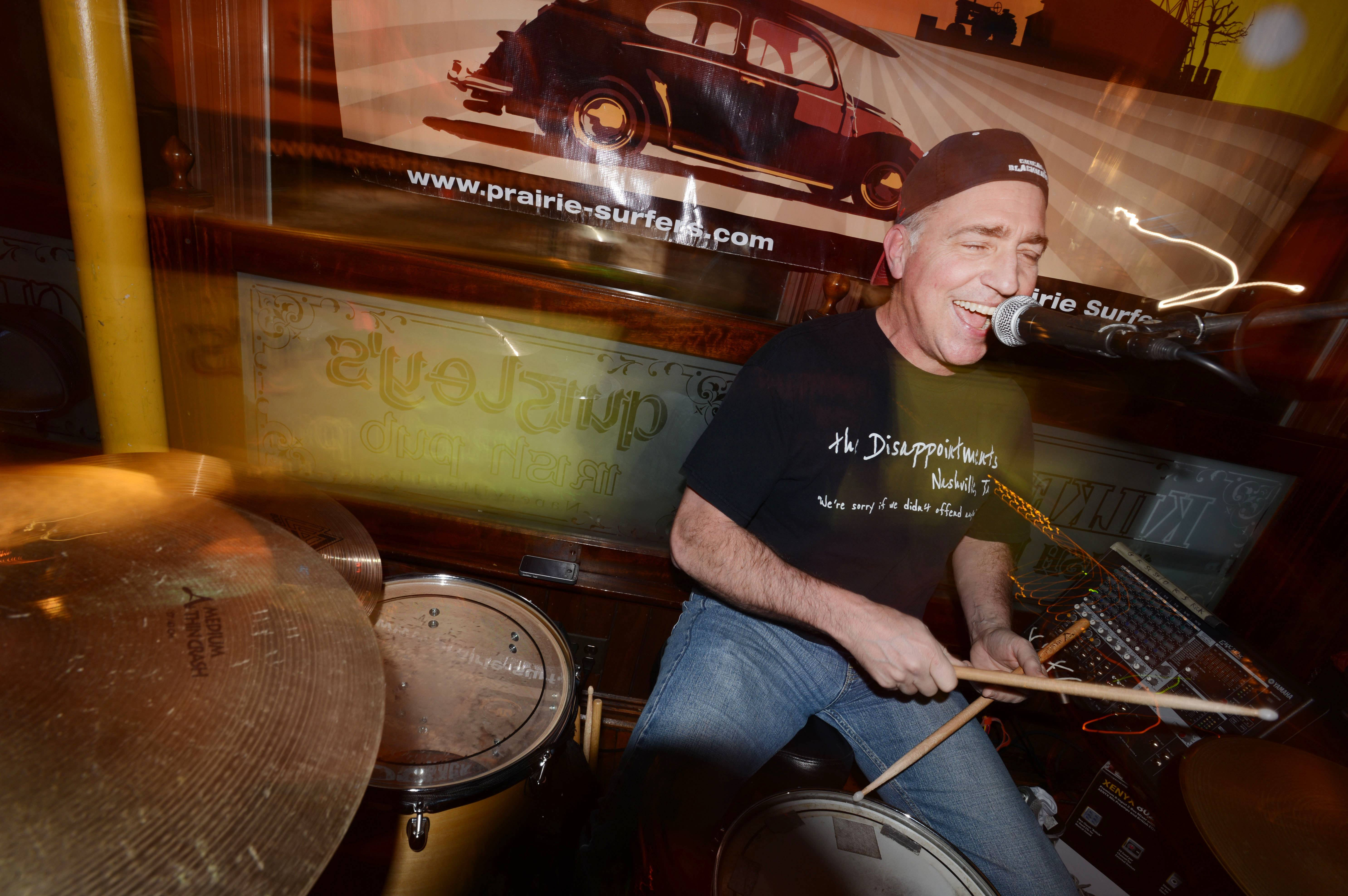 After becoming the ninth person to have a new type of surgery at Northwestern Memorial Hospital in Chicago to remove a tumor in his brain, Steve Mores of Aurora is back to playing drums with his band the Prairie Surfers at Quigley's Irish Pub in Naperville.