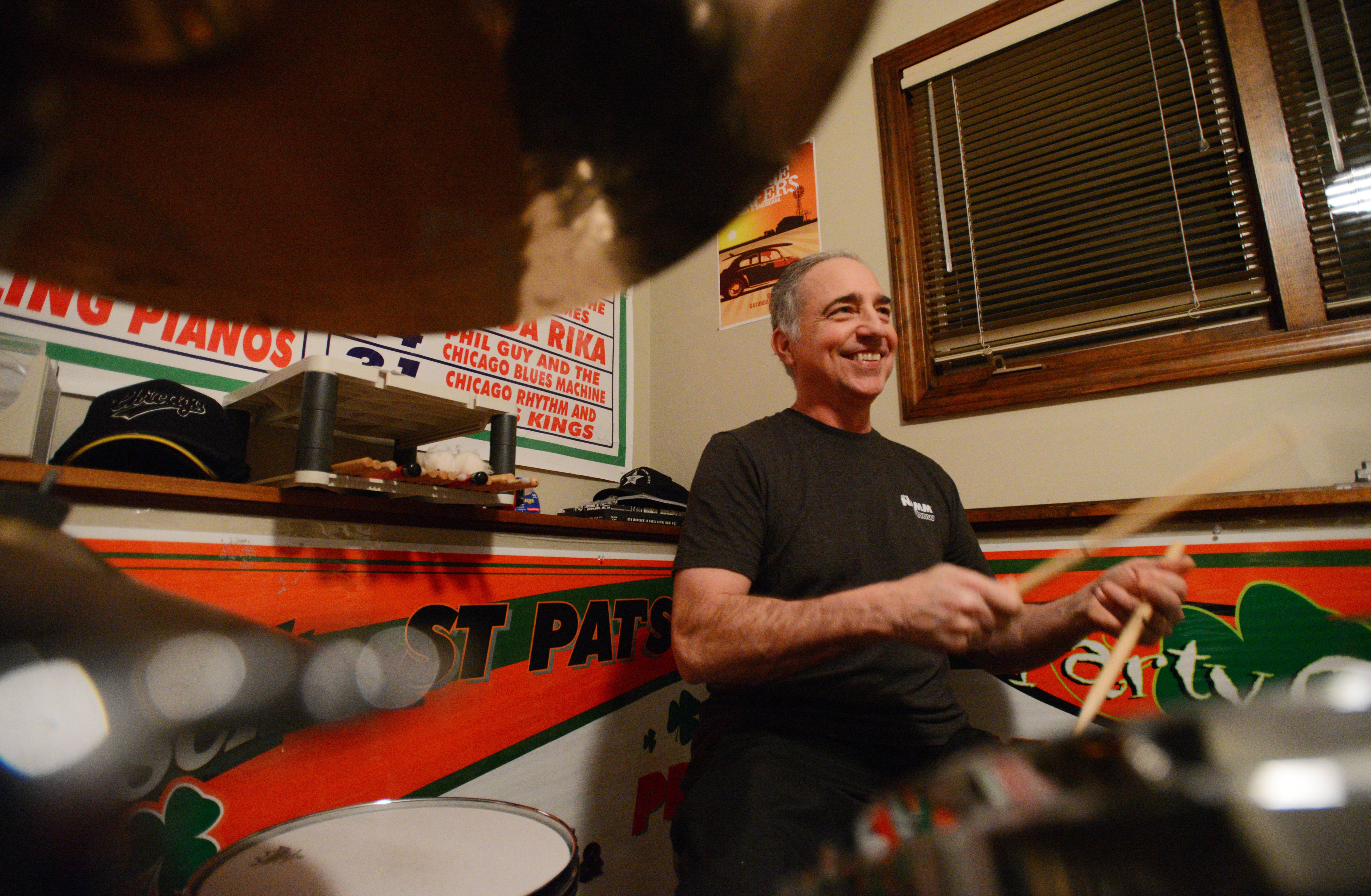 "Steve Mores, 57, of Aurora says he lost a little of his hearing from a tumor on his brain stem, but now he ""feels great"" and can play drums again."