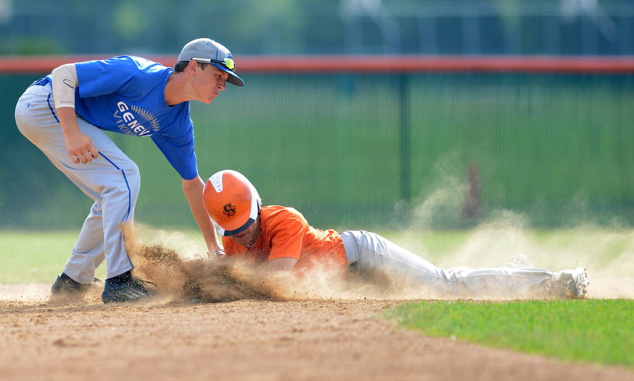 Geneva's Jack Wassel, pictured applying a tag against St. Charles East's Austin Regelbrugge who was safe on the play, will be a big part of the Vikings' lineup after hitting .327 with 29 RBI last year. Regelbrugge is one of the best left-handed pitchers in the area who will play right field when he doesn't pitch.