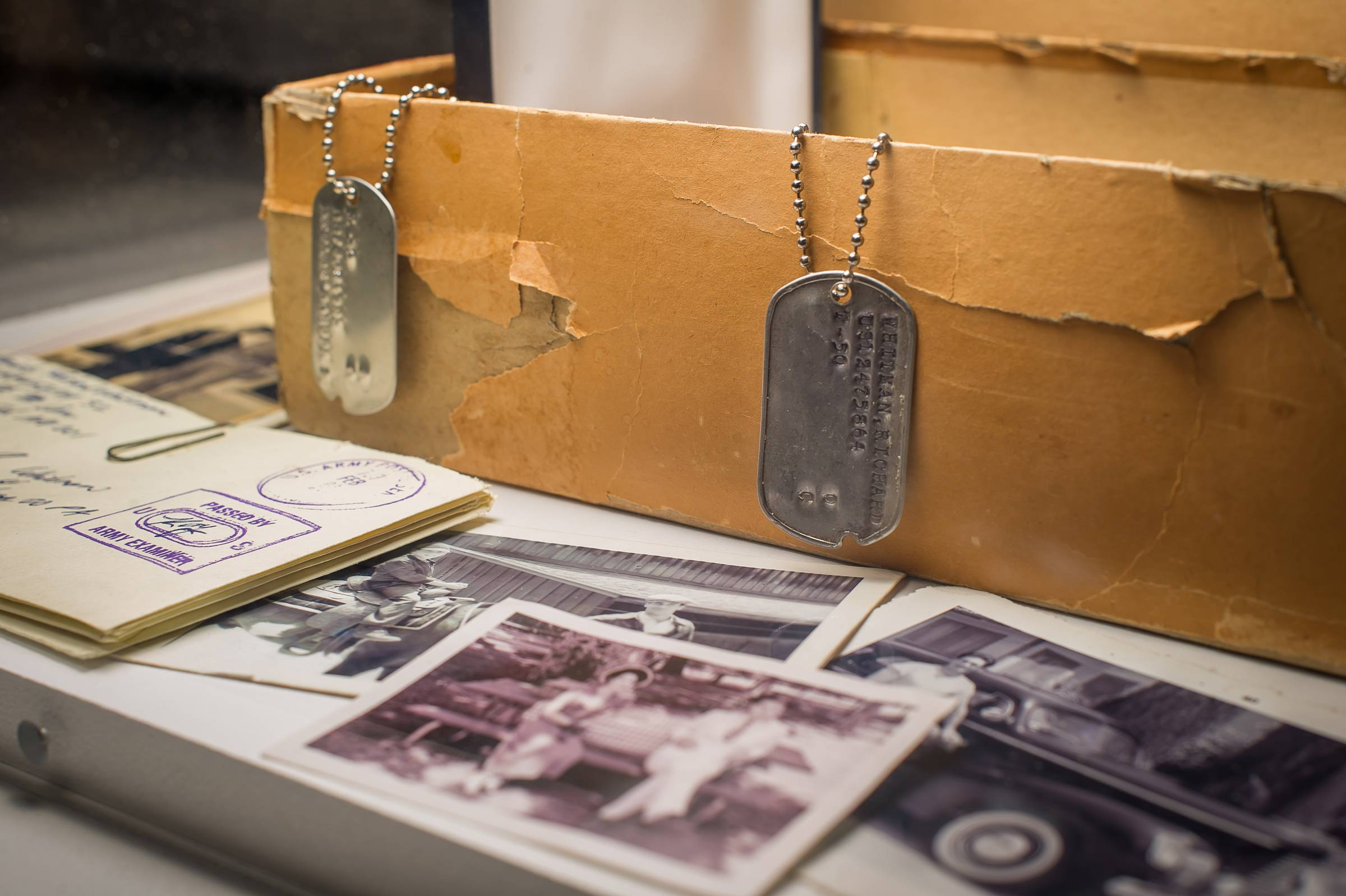 "Character Don Draper's box of secrets, including Dick Whitman's dog tag, letters and family photos are displayed as part of the exhibition ""Matthew Weiner's Mad Men"" at the Museum of the Moving Image in New York."