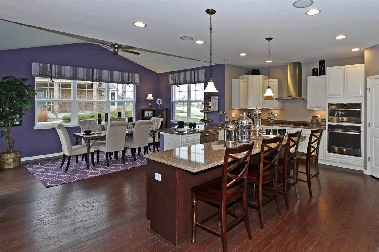 Most of today's new homes feature open floor plans, with the main living spaces open to the kitchen.