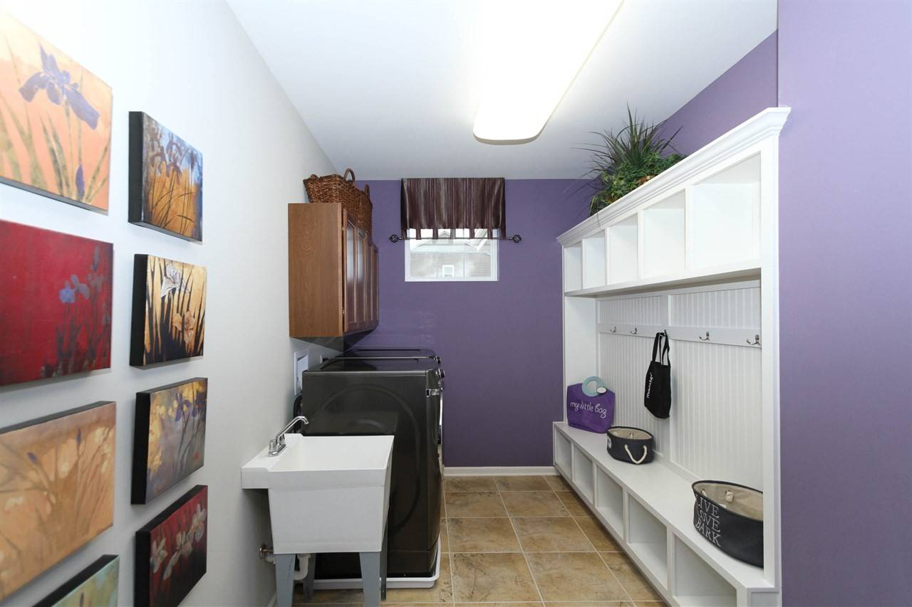 Mud rooms, many with storage and a spot to recharge electronics, are a popular choice in new homes today.