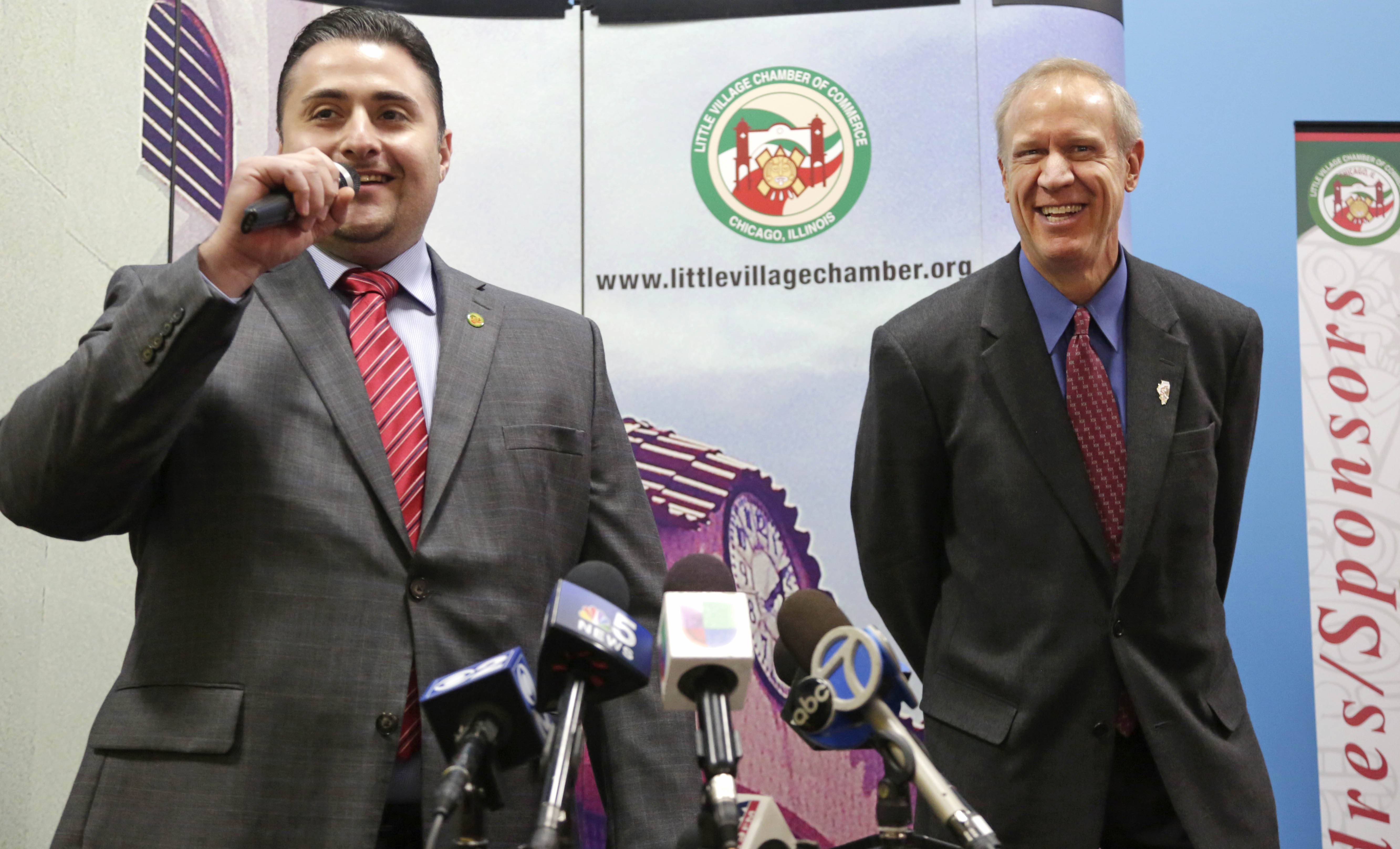 Julio Rodriguez introduces Gov. Bruce Rauner to business leaders Friday in the Little Village neighborhood of Chicago. More than two months after taking the reins of one of the nation's most immigrant-friendly states, Rauner has offered mixed signals about his stance on immigration.