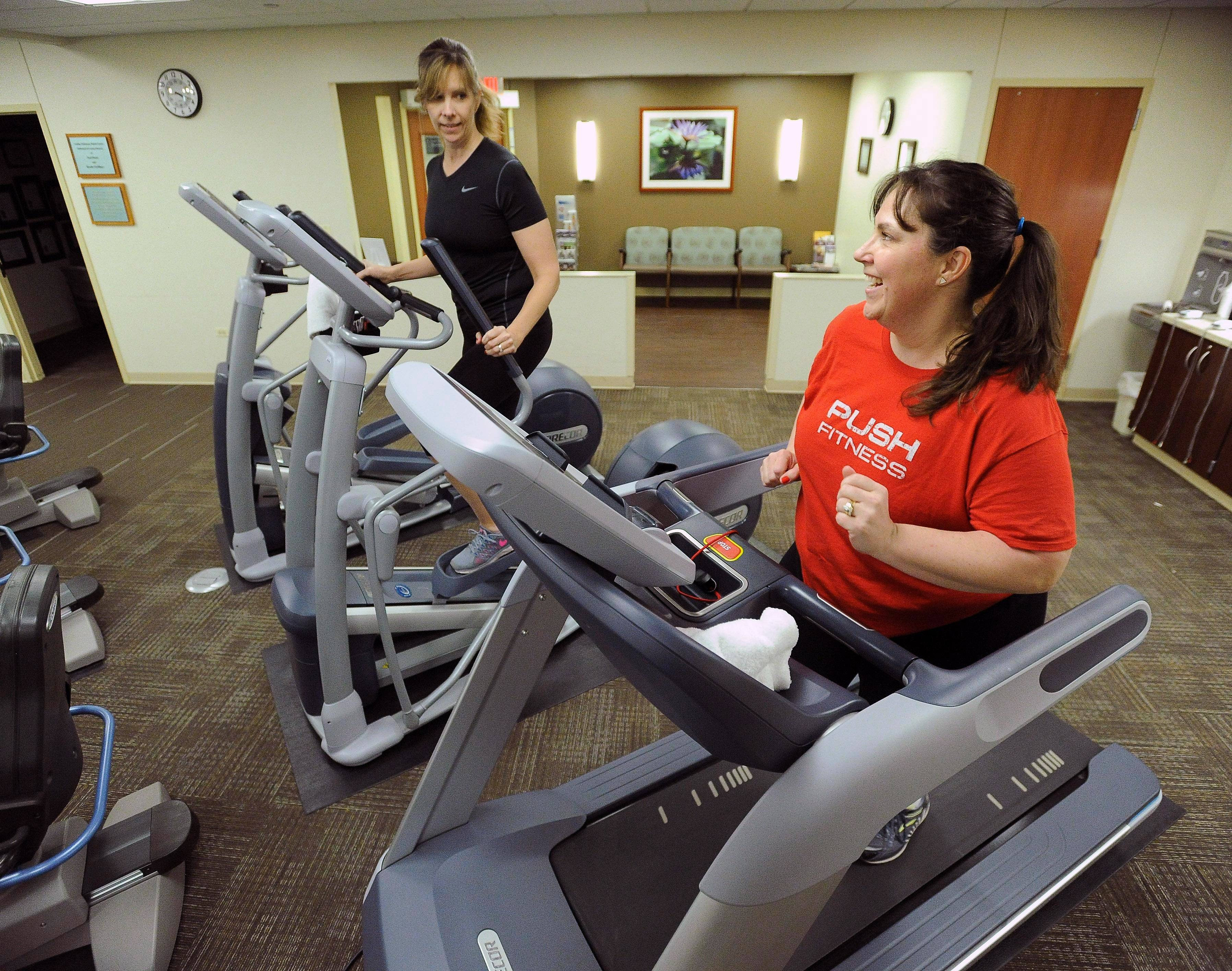 Fittest Loser Heidi Wiltse works out with her friend Susan Brady who keeps her smiling and motivated at Good Shepherd Hospital in Barrington.