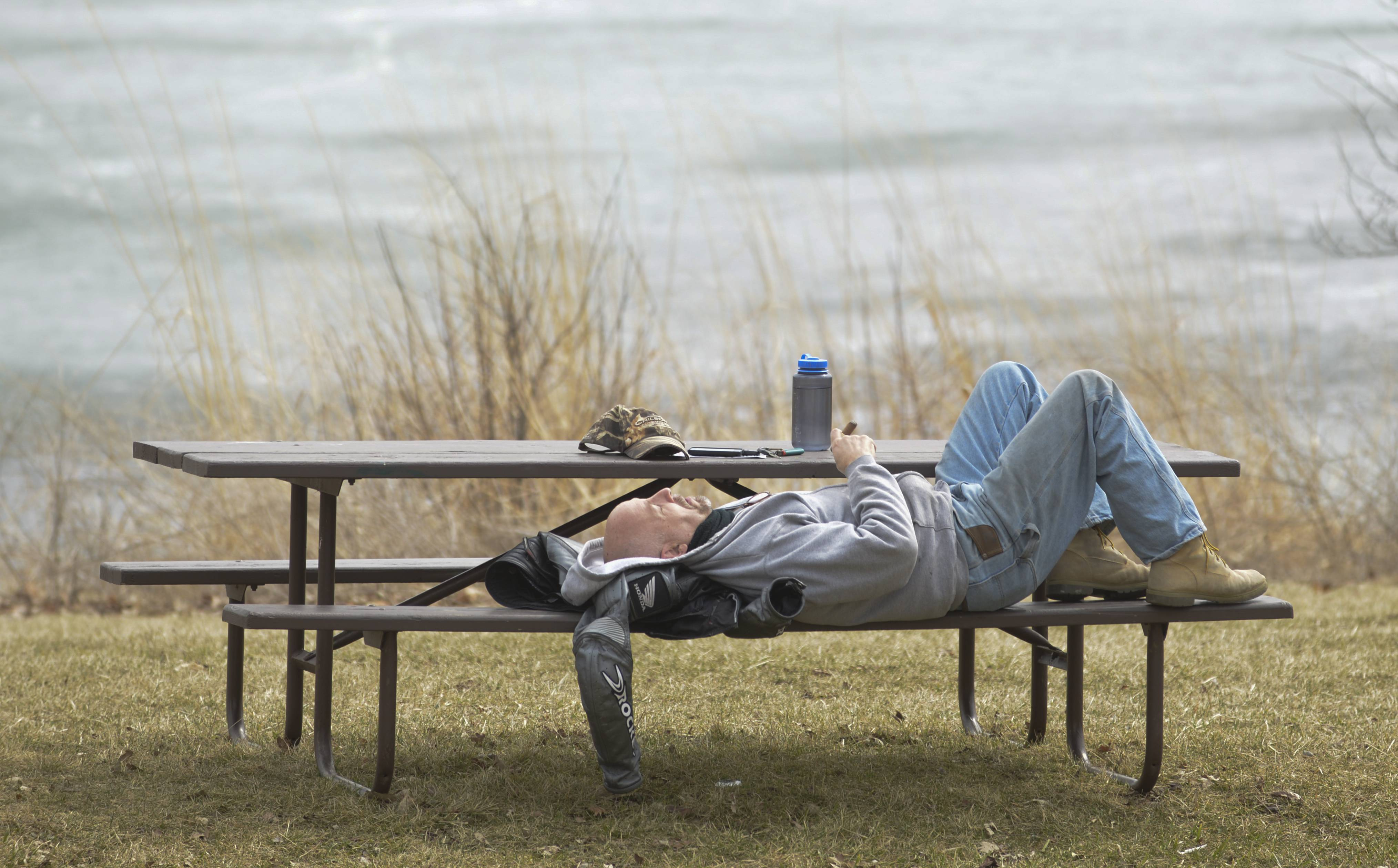 Stu Betts, of Naperville, relaxes on a bench in the Blackwell Forest Preserve Monday afternoon after taking his motorcycle out for a ride. The warm weather prompted many DuPage County residents to head outdoors.