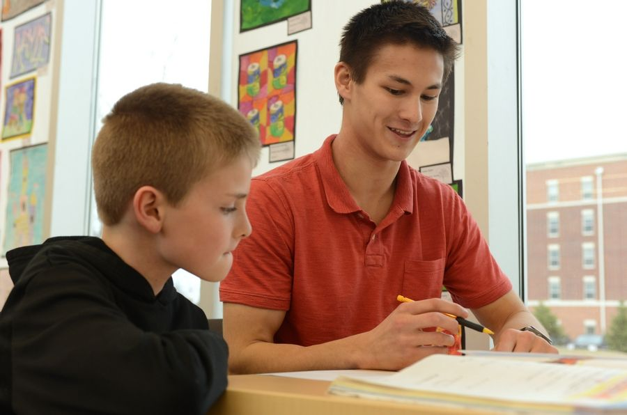 Stevenson High School senior Matthew Zalewski, right, tutors Aspen Elementary fourth-grader Dylan Sherwin of Vernon Hills at the Aspen Drive Library. Zalewski of Buffalo Grove has launched Epiphamatics, a tutoring company specializing in math support for elementary and middle school students.