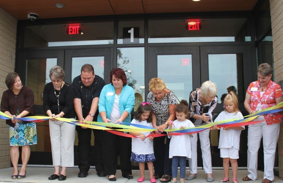 Students and school board members cut the ribbon to open Schaumburg Township Elementary District 54's Early Learning Center in Schaumburg last fall.