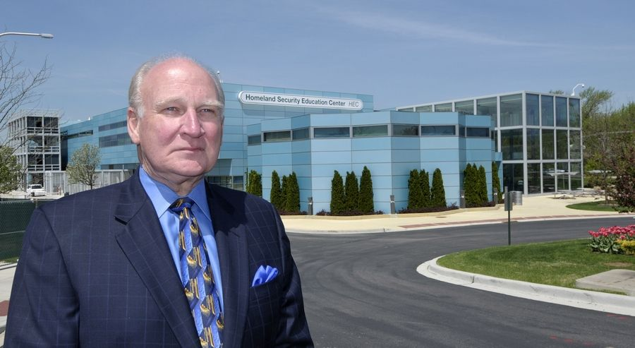College of DuPage President Robert Breuder stands in front of the Homeland Security Education Center building that would be named for him under his severance deal.