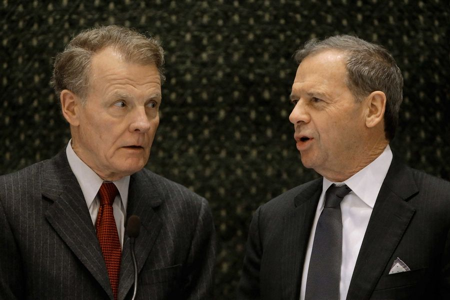 Illinois House Speaker Michael Madigan, left, and Senate President John Cullerton sent Gov. Bruce Rauner the budget fix he's been asking for. Rauner signed it into law Thursday.