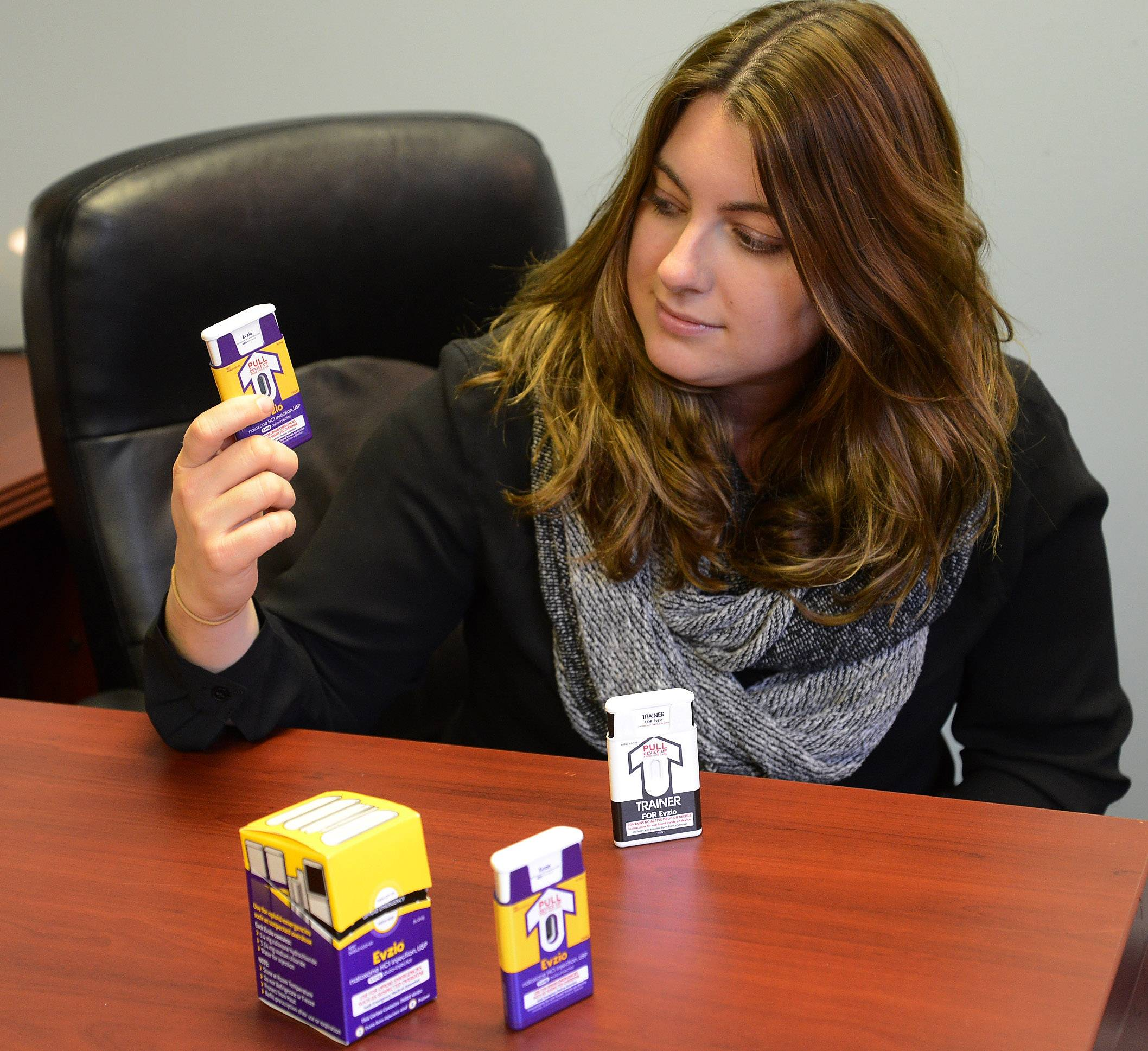 Chelsea Laliberte holds a portable naloxone injection system Wednesday at Live 4 Lali's walk-in clinic in Arlington Heights, the first of its kind in the suburbs.